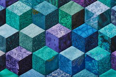 Detail of quilt sewn from rhombuses Royalty Free Stock Photo