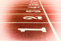 Race track for running competitions numbers and lanes Royalty Free Stock Photo