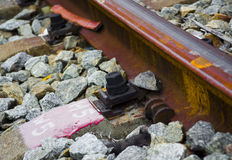 The detail of railway in a town. Screw on the track,on behalf of the Industrial details Royalty Free Stock Photos