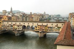 Detail in the rain of  the Ponte Vecchio Bridge. Over the Arno River,Florence , Italy stock photo