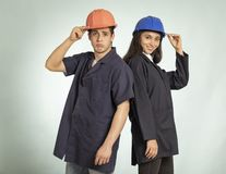 Detail of real mechanic man and woman stock photography