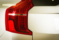Detail of the rear end of a silver car. With focus on the brake lights royalty free stock image
