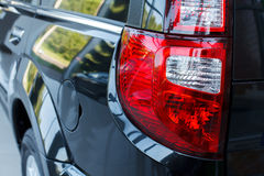 Detail on the rear light of a car. Royalty Free Stock Image