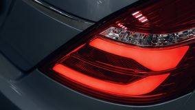 Detail on the rear light of a car stock photos