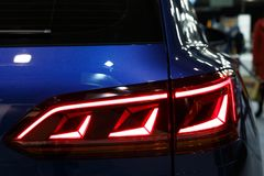 Detail on the rear light of a car stock photography