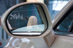 Detail (rear view mirror) of a personal luxury car Bentley New Continental GT V8 convertible. Royalty Free Stock Images