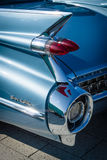 Detail of the rear wing and brake lights of the car Cadillac Coupe de Ville, 1959. Royalty Free Stock Photos