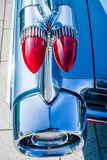 Detail of the rear wing and brake lights of the car Cadillac Coupe de Ville, 1959. Royalty Free Stock Photo