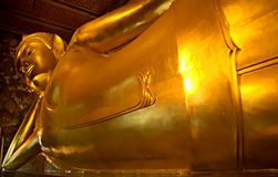 Detail of the Reclining Buddha statue at the Wat Pho temple. Detail of the Reclining Buddha statue at the Wat Pho temple in Bangkok, Thailand. The image Stock Image