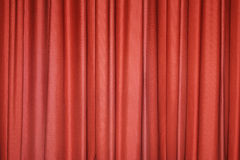Red curtain. Detail of a red closed curtain in a theatre Stock Photography
