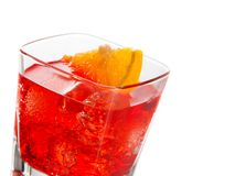 Detail of red cocktail with orange slice isolated on white background Royalty Free Stock Photos