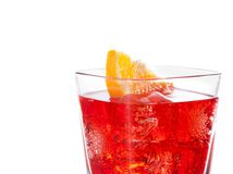 Detail of red cocktail with orange slice isolated on white background Royalty Free Stock Photo