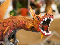 Detail: Red Dragon mouth. The open mouth of a sculpture representing a big red dragon Stock Photo