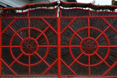 Detail of a red forged metallic gate Stock Photos