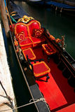 Detail of Red Gondola. Gondola in the small canals of the romantic Venice Stock Photos