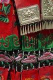 Detail of ethnic minorities costume. Detail of red and green ethnic minorities costume from china stock images