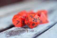 Detail of red Icosahedron dice. Group of different red role play dice with detail of Icosahedron dice twenty number face in selective focus Stock Photography