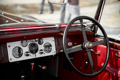 Detail of a red interior of a vintage car convertible. Close-up of a red interior of a vintage car convertible stock images