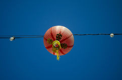 Red lantern. Detail of red lantern against a blue sky Royalty Free Stock Photos