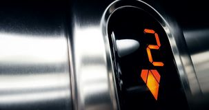 Detail of red led number of elevator that go down from the third floor to the first, business and stock video footage