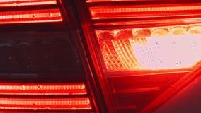 Detail of red metallized black rear car headlight in eye shape. Detail of red metallized black rear car headlight in eye shape stock video footage