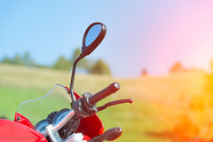 Detail of red motorcycle in the mountains Stock Photo