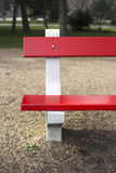 Detail of red painted park bench. Detail of empty red painted park bench royalty free stock images