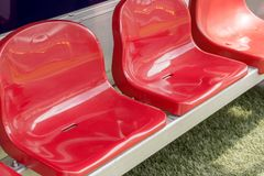 Detail of Reserve chair and staff coach bench in sport stadium. Detail of red Reserve chair and staff coach bench in sport stadium Stock Photography