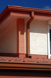 Detail of red roof. And gutter on house Stock Photo
