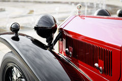 Detail of a red vintage car. Close-up of a red vintage car Royalty Free Stock Image