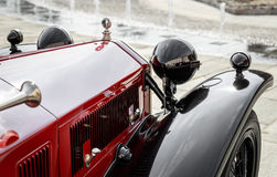 Detail of a red vintage car. Close up of a red vintage car Royalty Free Stock Photography