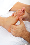 Detail of reflexology massage Stock Photos