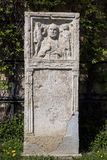 Detail of the relief from the Roman Empire era. Remnant of the relief from the Roman Empire era at public park stock photo