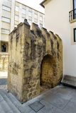 Detail of the remains of a medieval stone gate located next to the facade of the National Museum called de Machado Castro in Coimb. Ra, Portugal Royalty Free Stock Photos