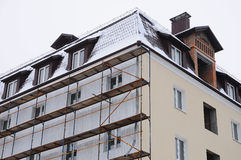 Detail renovation of house with scaffolding. Reconstruction of old building Royalty Free Stock Photography