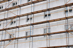 Detail renovation of house with scaffolding. Reconstruction of old building Stock Photography