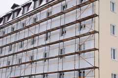 Detail renovation of house with scaffolding. Reconstruction of old building.  stock photo