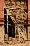 Traditional Brazilian building construction called `pau-a pique`. Detail of restoration on the exposed structure of a 18th century mud wall. São Luiz do Royalty Free Stock Photo