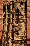 Traditional Brazilian building construction called `pau-a pique`. Detail of restoration on the exposed structure of a 18th century mud wall. São Luiz do Royalty Free Stock Photography
