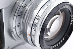 Detail of retro analog camera lens. Engravings isolated on white Royalty Free Stock Photography