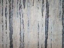 Detail of ridged grey stone masonry. Detail of roughly ridged aging grey stone masonry with dark weathered streaks Stock Photo