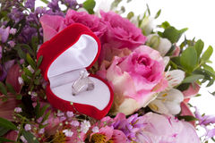 Detail of the rings and bouquet. Betrothal detail of the rings and bouquet Royalty Free Stock Image