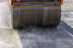 Detail of road roller during asphalt patching works 2 Stock Photos