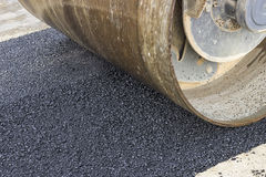 Detail of road roller during asphalt patching works Royalty Free Stock Photo