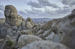 Detail of the rock formation of the southern Sardinian coasts. Beautiful cliff on the southern coast of Sardinia, formed by granite rock shaped by the sea and royalty free stock photo