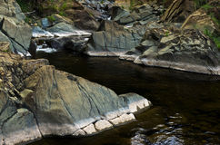 Detail of rocks in water at Black river gorge Stock Photo