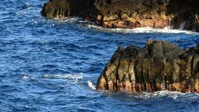 Detail of rocks and waves.Slow motion. stock footage