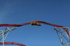 A roller coaster very high up ready to speed stock photo