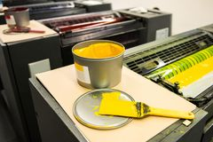 Detail of rollers in offset printing machine. Offset machine. ink color drums in a print machine Stock Image