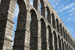 Detail of the Roman Aqueduct of Segovia. In a sunny day Royalty Free Stock Image